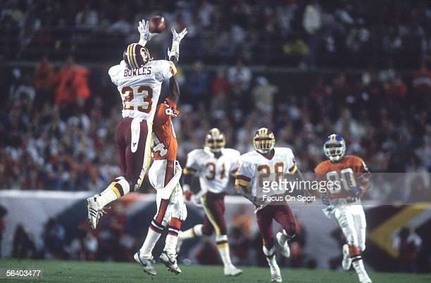 Todd Bowles cornerback of the Washington Redskins breaks up a pass to Denver Broncos' Ricky Nattiel during Super Bowl XXII on January 31 1988 in San...