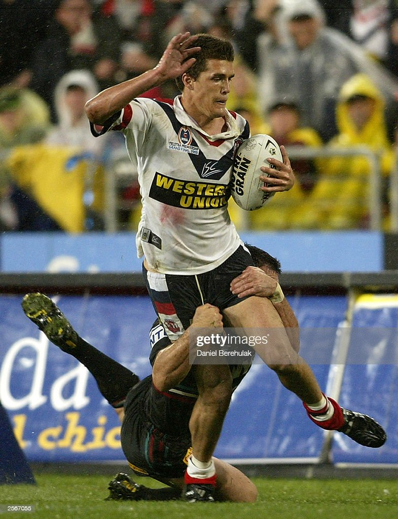 Todd Byrne #2 of the Roosters is tackled by Scott Sattler #13 of the Panthers during the NRL Grand Final between the Sydney Roosters and the Penrith Panthers at Telstra Stadium October 5, 2003 in Sydney, Australia. Penrith won 18-6.