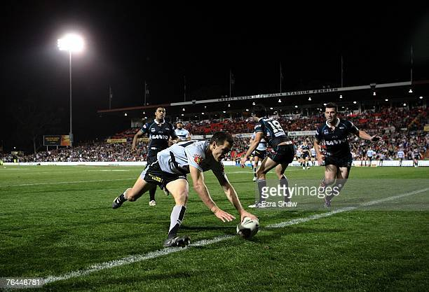 Todd Byrne of the Warriors scores a try during the round 25 NRL match between the Penrith Panthers and the New Zealand Warriors at CUA Stadium...