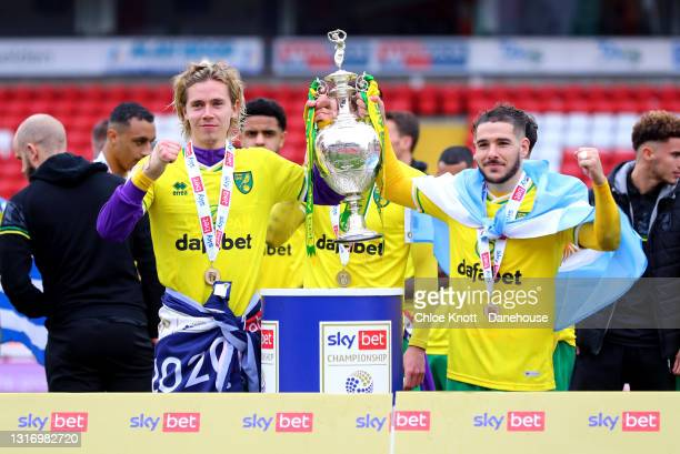 Todd Cantwell and Emilian Buendia of Norwich City pose with the Sky Bet Championship trophy during the Sky Bet Championship match between Barnsley...