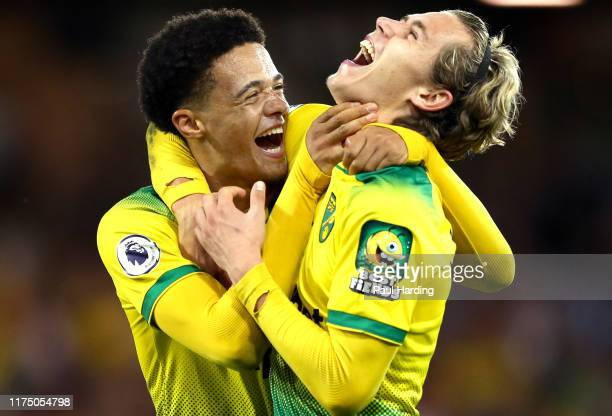 Todd Cantwell and Jamal Lewis of Norwich City celebrate following their sides victory in during the Premier League match between Norwich City and...