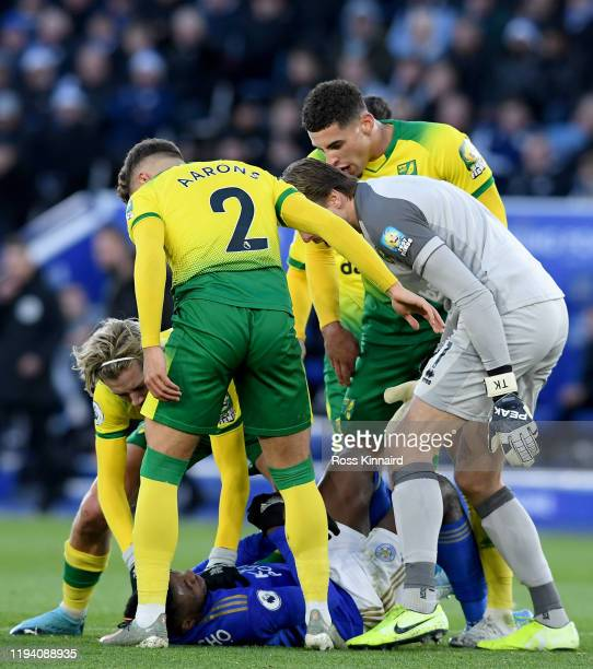 Todd Cantwell Max Aarons Tim Krul and Ben Godfrey of Norwich surround Kelechi Iheanacho of Leicester during the Premier League match between...