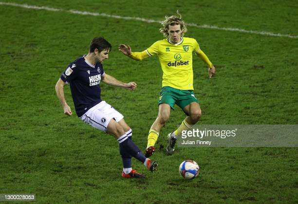 Todd Cantwell of Norwich battles with Ryan Leonard of Millwall FC during the Sky Bet Championship match between Millwall and Norwich City at The Den...