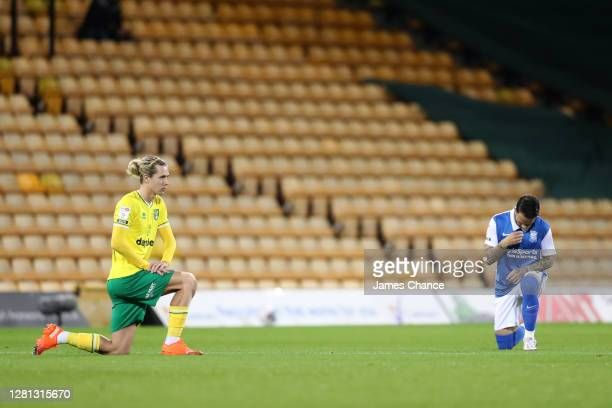 Todd Cantwell of Norwich City and Ivan Sanchez of Birmingham City takes a knee in support of the Black Lives Matter movement prior to during the Sky...