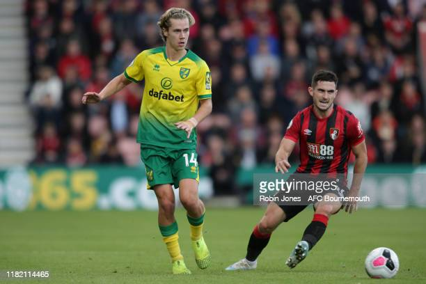 Todd Cantwell of Norwich City and Lewis Cook of Bournemouth during the Premier League match between AFC Bournemouth and Norwich City at Vitality...