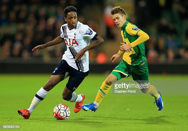 Todd Cantwell of Norwich City and Shayon Harrison of Tottenham Hotspur compete for the ball during the Barclays U21 Premier League match between...