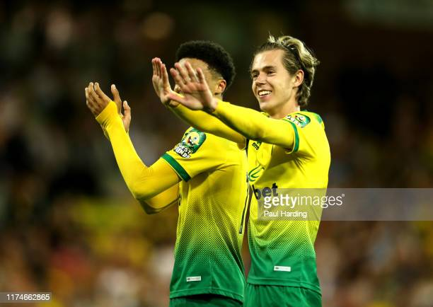 Todd Cantwell of Norwich City celebrates following his sides victory in the Premier League match between Norwich City and Manchester City at Carrow...