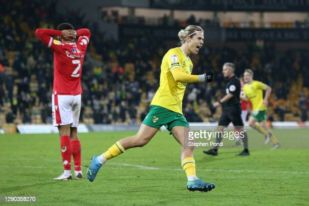 Todd Cantwell of Norwich City celebrates their team's second goal scored by Emi Buendia of Norwich City during the Sky Bet Championship match between...
