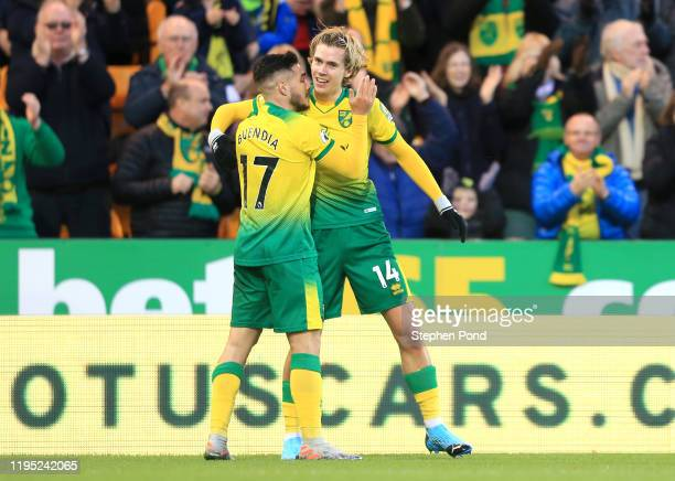 Todd Cantwell of Norwich City celebrates with his teammate Emiliano Buendia after scoring his team's first goal during the Premier League match...