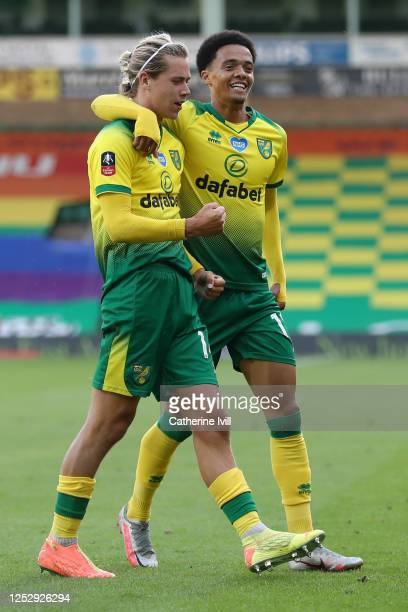 Todd Cantwell of Norwich City celebrates with Jamal Lewis of Norwich City after scoring his teams first goal during the FA Cup Quarter Final match...