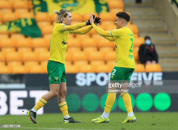 Todd Cantwell of Norwich City celebrates with team mate Max Aarons after scoring their side's first goal during the Sky Bet Championship match...