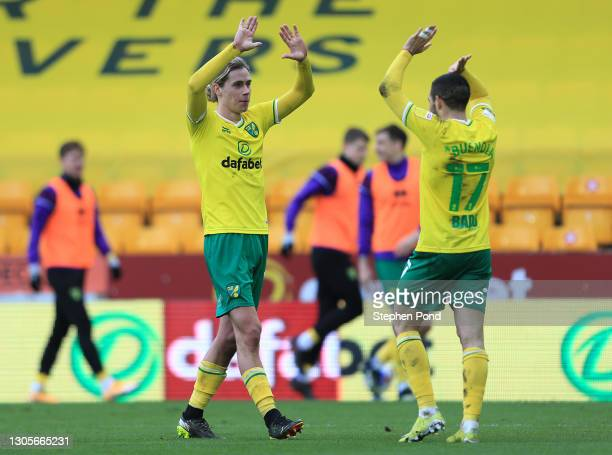 Todd Cantwell of Norwich City celebrates with teammate Emiliano Buendia after scoring his team's third goal during the Sky Bet Championship match...
