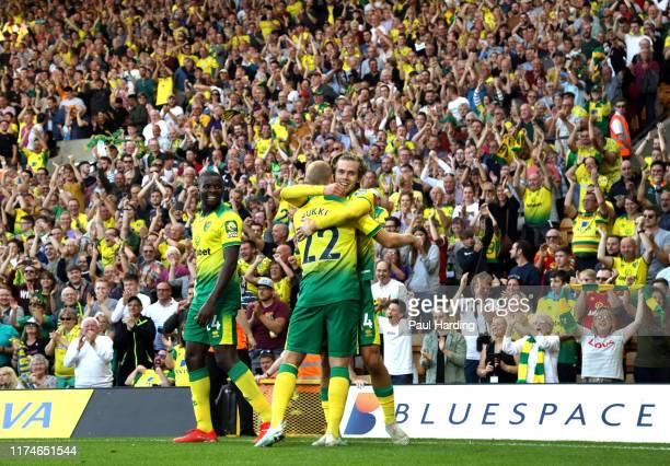 Todd Cantwell of Norwich City celebrates with teammates after scoring his team's second goal during the Premier League match between Norwich City and...