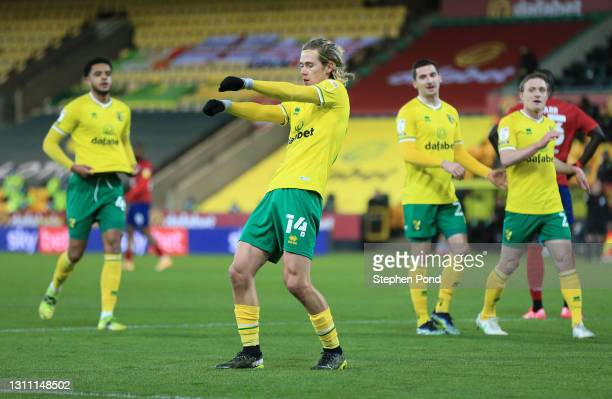 Todd Cantwell of Norwich City celebrates with teammates after scoring their team's fourth goal during the Sky Bet Championship match between Norwich...