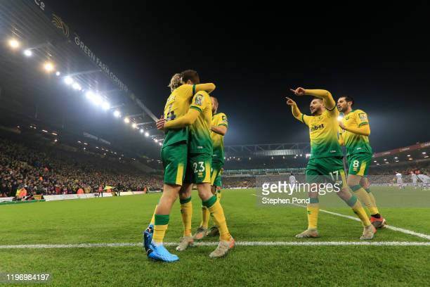 Todd Cantwell of Norwich City celebrates with teammates Kenny McLean Emiliano Buendia and Mario Vrancic of Norwich City after scoring his team's...