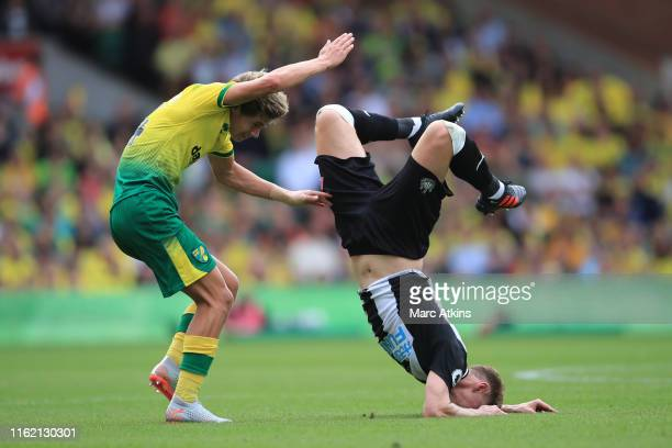 Todd Cantwell of Norwich City collides with Emil Krafth of Newcastle United during the Premier League match between Norwich City and Newcastle United...