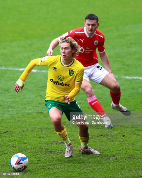 Todd Cantwell of Norwich City controls the ball under pressure of Liam Kitching of Barnsley during the Sky Bet Championship match between Barnsley...