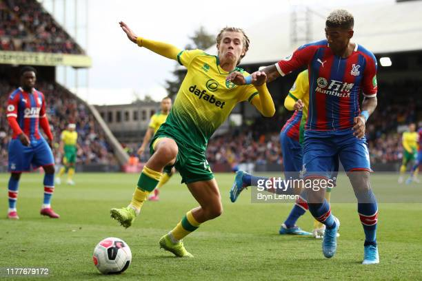 Todd Cantwell of Norwich City defends the ball from Patrick van Aanholt of Crystal Palace during the Premier League match between Crystal Palace and...