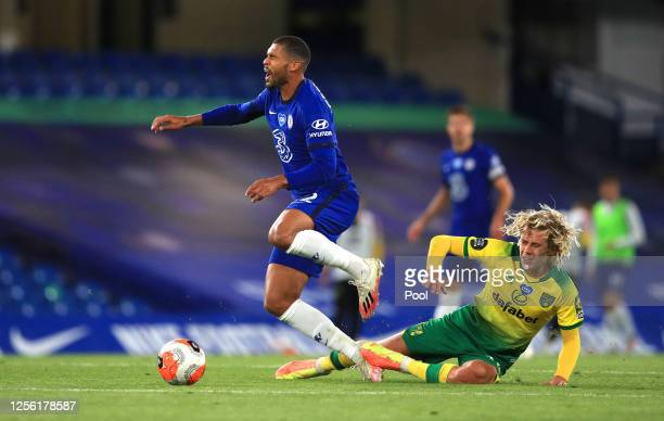 Todd Cantwell of Norwich City fouls Ruben LoftusCheek of Chelsea during the Premier League match between Chelsea FC and Norwich City at Stamford...