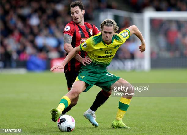 Todd Cantwell of Norwich City is challenged by Adam Smith of AFC Bournemouth during the Premier League match between AFC Bournemouth and Norwich City...