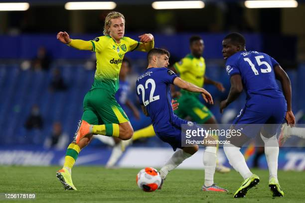 Todd Cantwell of Norwich City is challenged by Christian Pulisic and Kurt Zouma of Chelsea during the Premier League match between Chelsea FC and...