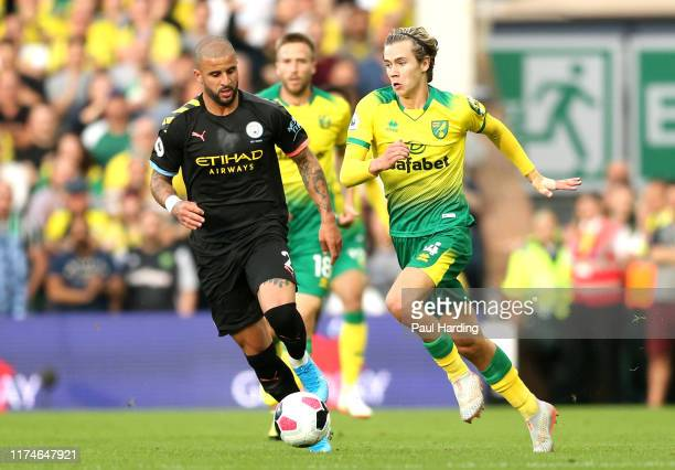 Todd Cantwell of Norwich City is challenged by Kyle Walker of Manchester City during the Premier League match between Norwich City and Manchester...