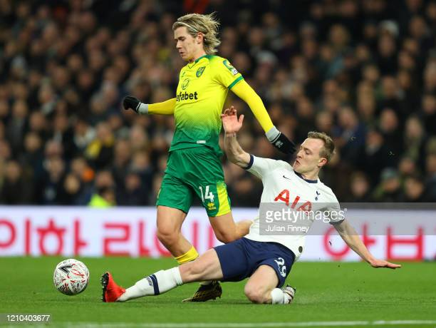 Todd Cantwell of Norwich City is tackled by Oliver Skipp of Tottenham Hotspur during the FA Cup Fifth Round match between Tottenham Hotspur and...