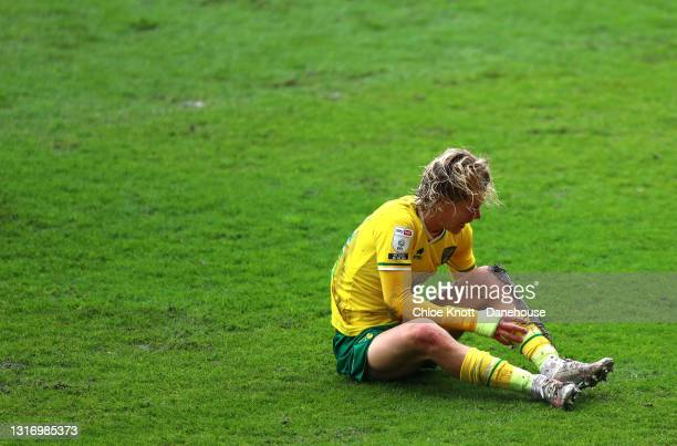 Todd Cantwell of Norwich City pulls up his socks during the Sky Bet Championship match between Barnsley and Norwich City at Oakwell Stadium on May...