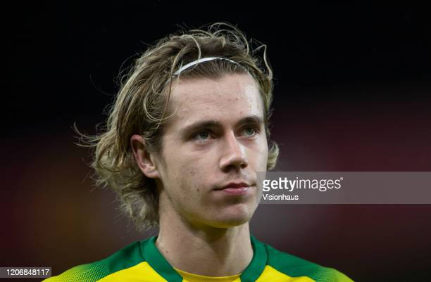 Todd Cantwell of Norwich City rests his boot on the ball during the Premier League match between Norwich City and Liverpool FC at Carrow Road on...