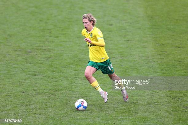 Todd Cantwell of Norwich City runs with the ball during the Sky Bet Championship match between Barnsley and Norwich City at Oakwell Stadium on May...