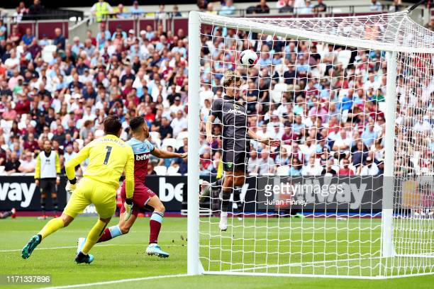 Todd Cantwell of Norwich City shoots a header during the Premier League match between West Ham United and Norwich City at London Stadium on August 31...