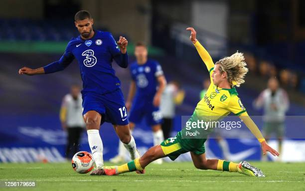Todd Cantwell of Norwich City tackles Ruben LoftusCheek of Chelsea during the Premier League match between Chelsea FC and Norwich City at Stamford...