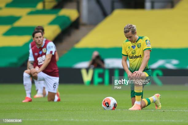 Todd Cantwell of Norwich City takes a knee in support of the Black Lives Matter movement prior to the Premier League match between Norwich City and...