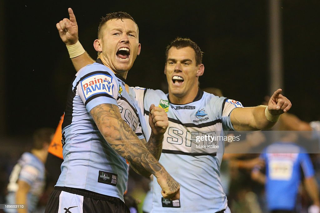 Todd Carney and John Morris of the Sharks celebrate victory during the round 11 NRL match between the Cronulla Sharks and the South Sydney Rabbitohs at Sharks Stadium on May 27, 2013 in Sydney, Australia.