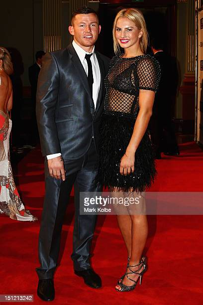 Todd Carney and Lauryn Eagle pose on the red carpet as they arrive for the 2012 NRL Dally M Awards at Sydney Town Hall on September 4 2012 in Sydney...