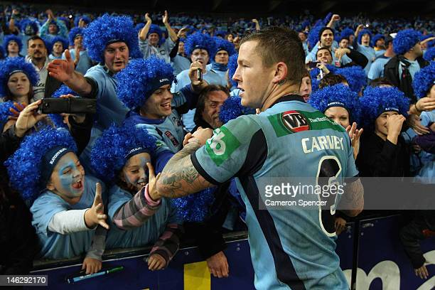 Todd Carney of the Blues celebrates with fans after winning game two of the ARL State of Origin series between the New South Wales Blues and the...