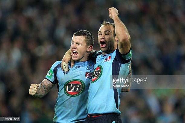 Todd Carney of the Blues celebrates with team mate Brett Stewart winning game two of the ARL State of Origin series between the New South Wales Blues...