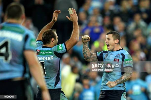 Todd Carney of the Blues celebrates with team mate Brett Stewart after winning game two of the ARL State of Origin series between the New South Wales...