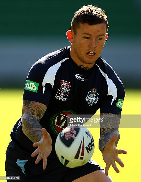 Todd Carney of the Blues looks to offload a pass during a New South Wales Blues State of Origin training session at AAMI Park on May 17 2012 in...