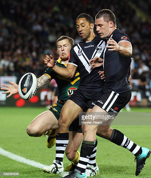Todd Carney of the Kangaroos competes with Benji Marshall and Shaun KennyDowall of the Kiwis for the ball during the Four Nations match between the...