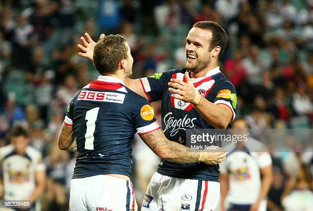 Todd Carney of the Roosters is congratulated by team mate Nate Myles after scoring during the round four NRL match between the Sydney Roosters and...