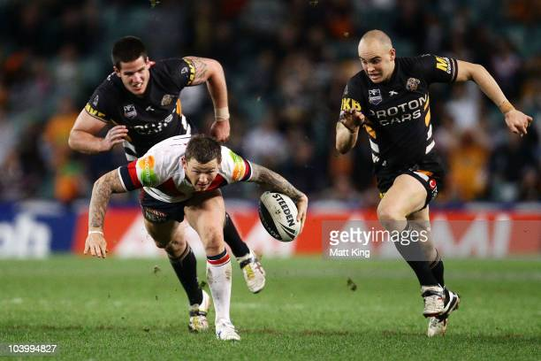Todd Carney of the Roosters makes a break during the NRL Second Qualifying Final match between the Wests Tigers and the Sydney Roosters at the Sydney...