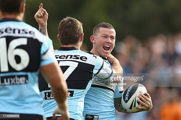 Todd Carney of the Sharks celebrates scoring a try during the round 20 NRL match between the Cronulla Sharks and the Penrith Panthers at Remondis...