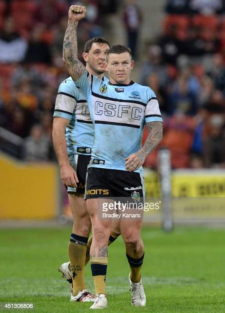 Todd Carney of the Sharks celebrates victory after the round 16 NRL match between the Brisbane Broncos and the Cronulla Sharks at Suncorp Stadium on...
