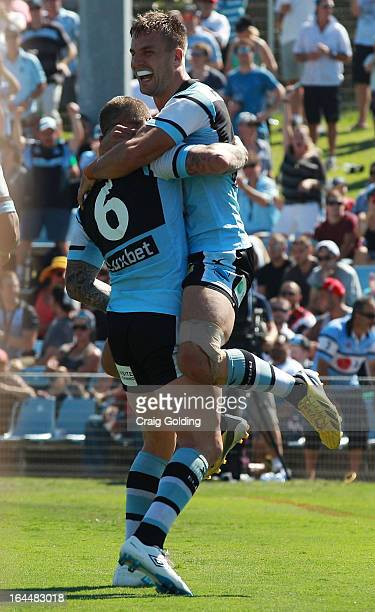 Todd Carney of the Sharks celebrates with Beau Ryan after scoring a try during the round three NRL match between the Cronulla Sharks and the New...