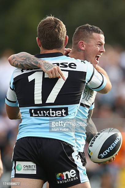 Todd Carney of the Sharks celebrates with his team mates after scoring a try during the round 20 NRL match between the Cronulla Sharks and the...