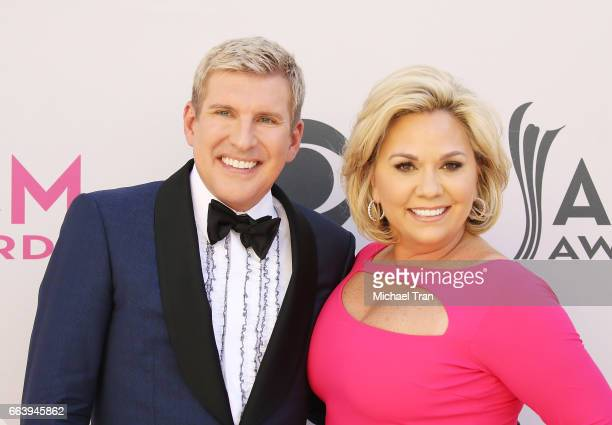 Todd Chrisley and Julie Chrisley arrive at the 52nd Academy of Country Music Awards held at TMobile Arena on April 2 2017 in Las Vegas Nevada