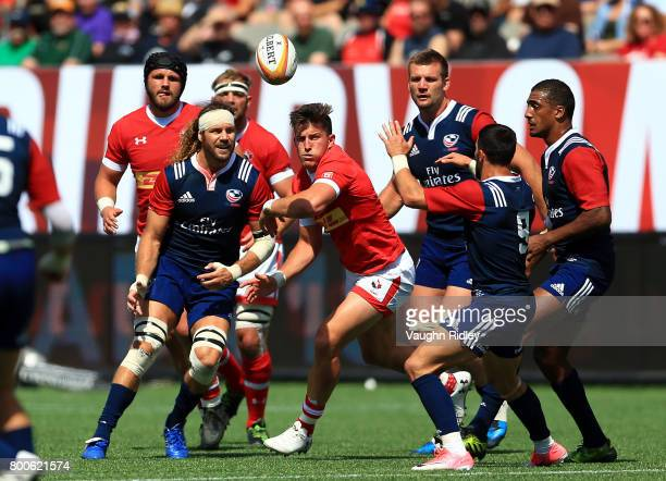 Todd Clever of the USA passes the ball to Nate Augspurger as DTH Van Der Merwe of Canada defends in the first half of a Rugby World Cup 2019...