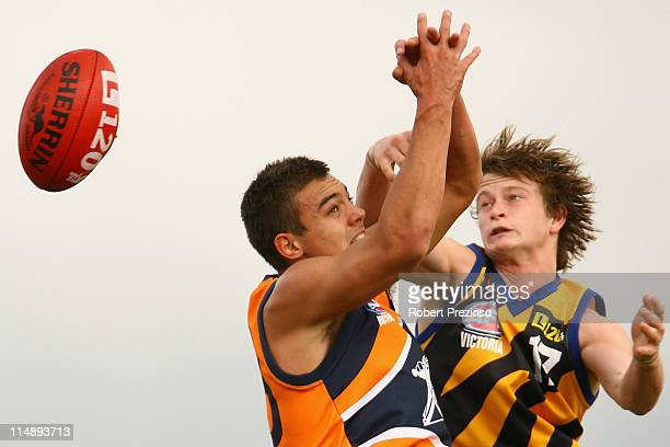 Todd Coran of the Cannons and Liam Sumner of the Dragons contest the ball during the round seven TAC Cup match between the Calder Cannons and the...