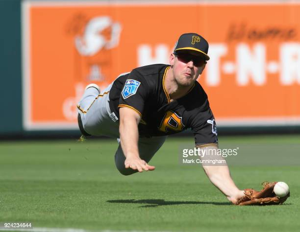 Todd Cunningham of the Pittsburgh Pirates tries to make a diving catch during the Spring Training game against the Detroit Tigers at Publix Field at...